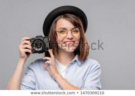 Happy young female photographer making you to pay attention in camera Stock photo © pressmaster