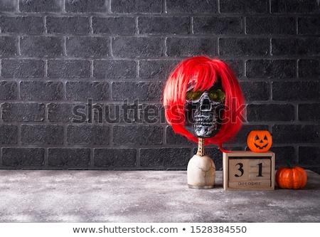 Emberi koponya piros paróka vicces halloween Stock fotó © furmanphoto