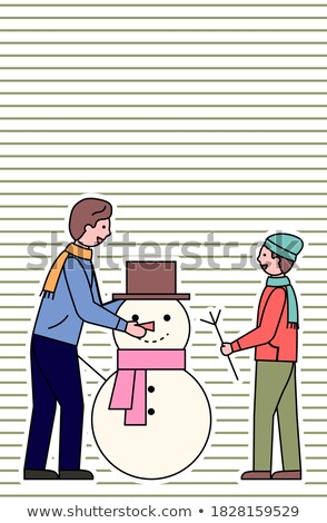 Happy Holidays Father and Kid Sculpting Snowman Stock photo © robuart