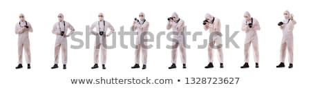 Forensic specialist in protective suit taking photos on a crime  Stock photo © lightpoet