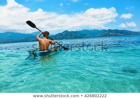 Summer Travel Kayaking. Man Paddling Transparent Canoe Kayak, Enjoying Recreational Sporting Activit Stock photo © galitskaya