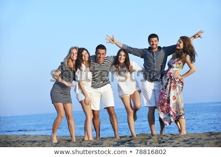 Happy People Group Have Fun And Running On Beach Сток-фото © dotshock