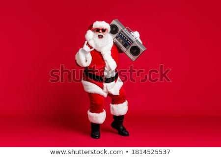 Rock and roll, Santa! Stock photo © feedough