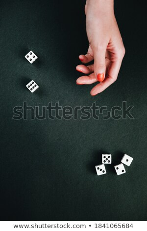 woman holding dices on black background Stock photo © imarin