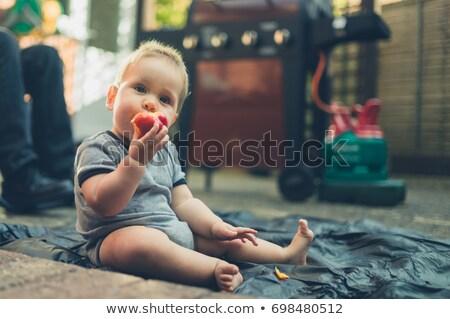 Fiatal srác eszik nektarin étel arc szemek Stock fotó © photography33