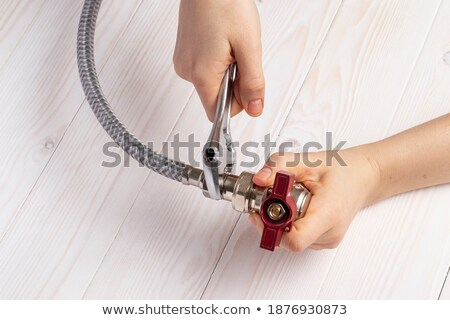 woman with metal flexible hoses stock photo © photography33