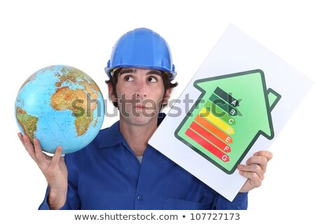 Stock photo: craftsman holding an energy consumption label