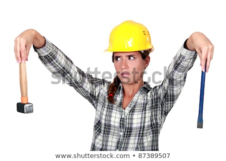 Apprehensive tradeswoman holding a hammer and chisel Stock photo © photography33