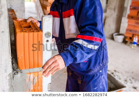 A bricklayer using a ruler Stock photo © photography33