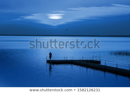 Relaxed man standing on a pontoon Stock photo © photography33