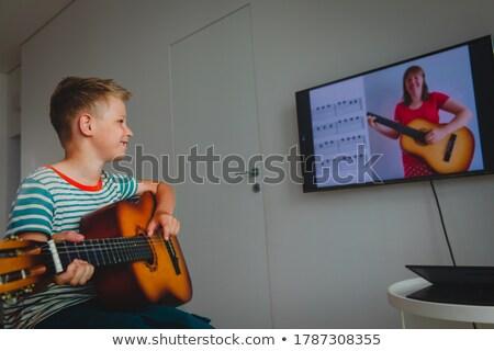 гитаре · урок · музыку · улыбка · счастливым · образование - Сток-фото © photography33