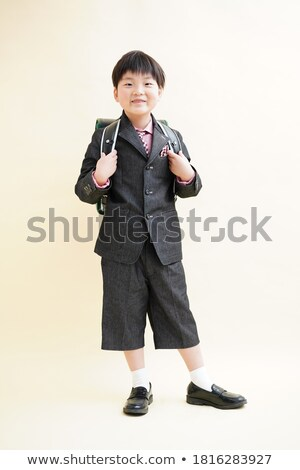 schoolboy carrying girl on his back stock photo © stockyimages