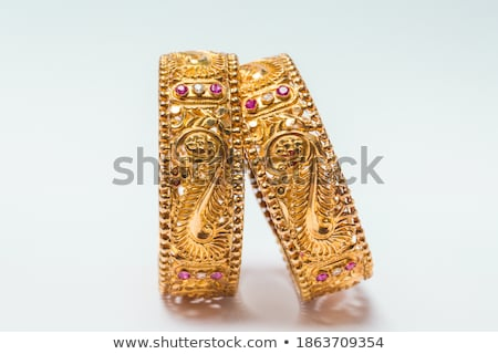 shining golden rings over red background Stock photo © marinini