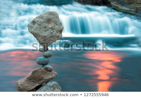 stack of stones balancing on a lake background stock photo © haraldmuc