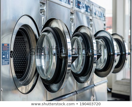Row of washing machines in laundromat Stock photo © PiXXart