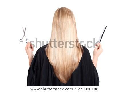 Blonde woman holding her hair on black background stock photo © wavebreak_media