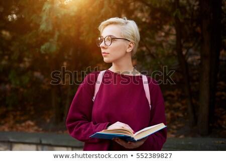 Motivado femenino estudiante nina rojo trabajador Foto stock © photography33