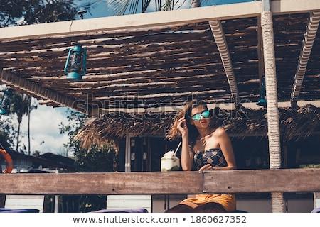 Fiatal nő élvezi ital tengerpart étterem Thaiföld Stock fotó © SophieJames