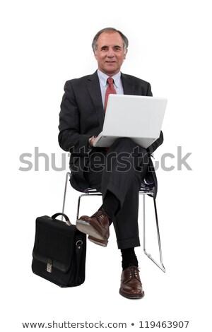 biznesmen · za · pomocą · laptopa · lobby · biuro · człowiek · miasta - zdjęcia stock © photography33
