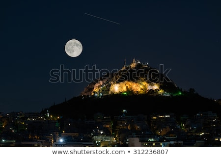 view of mount lycabettus in athens stock photo © elxeneize
