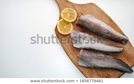 dried hake fish over white stock photo © lunamarina