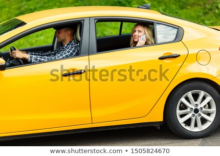 casual man looks to side while seated in grass stock photo © feedough