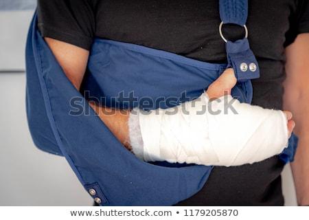 Close-up image of a white bandage wrapped on injured arm. Stock photo © pxhidalgo