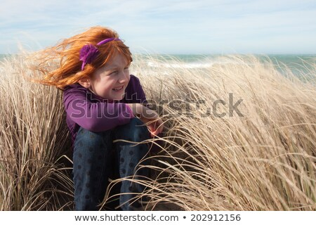 Woman posing on shore at windy day Stock photo © vetdoctor