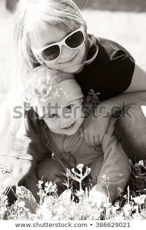 Sepia toned portrait of a beautiful blond girl with flowers Stock photo © Nejron