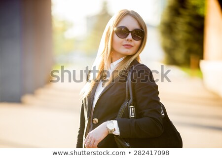 woman with sunglasses in black leather suit stock photo © nicoletaionescu