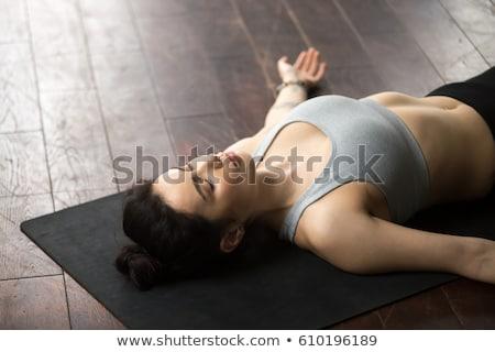 Stock photo: Woman lying on floor.