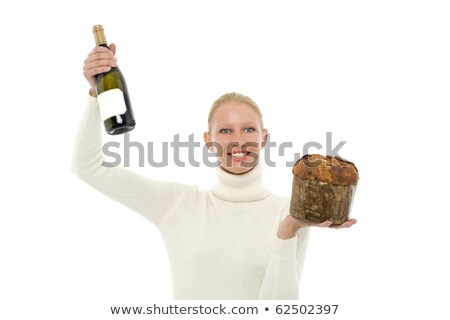 woman wearing a white turtleneck sweater and holding a panettone and a bottle of champagne celebrati stock photo © ambro