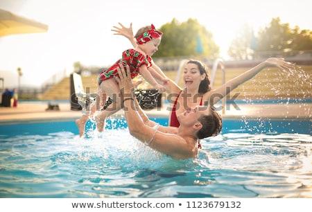 Baba kız eğlence havuz Stok fotoğraf © Yongkiet