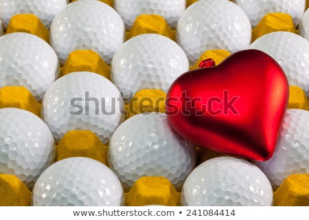 Golf balls in box for eggs and red heart  Stock photo © CaptureLight