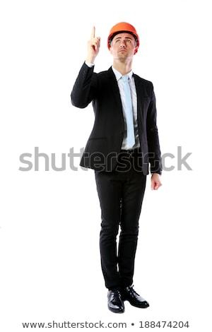 Portret biznesmen kask wskazując w górę kopia przestrzeń Zdjęcia stock © deandrobot