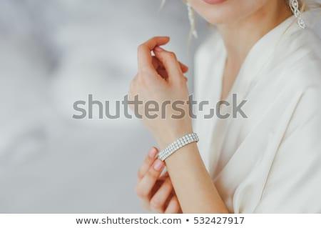 Nő karkötő gyönyörű barna hajú körül kar Stock fotó © lubavnel