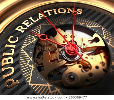 public relations on black golden watch face stock photo © tashatuvango