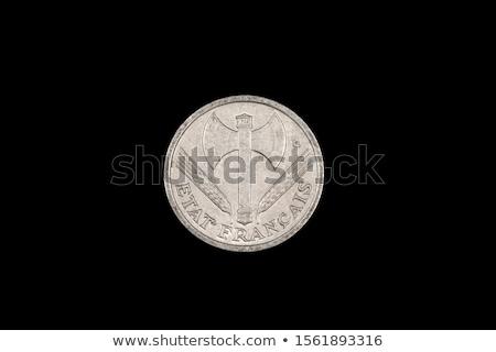 two fascist coins on a black background stock photo © tashatuvango