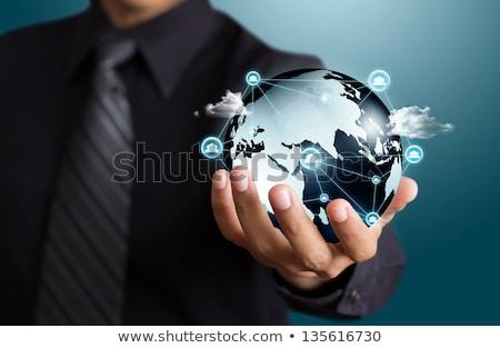 biznesmen · garnitur · świat · piłka · Pokaż · strony - zdjęcia stock © andreypopov