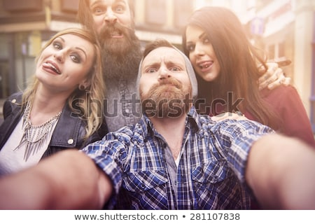 casual fashion man making a funny face stock photo © feedough