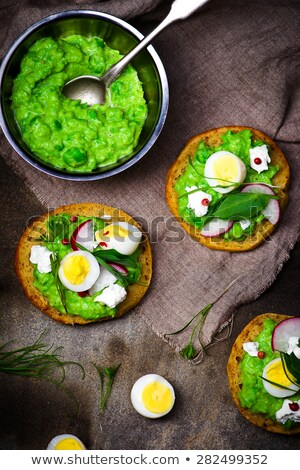Canape With Green Peas Paste And Eggs Stok fotoğraf © zoryanchik