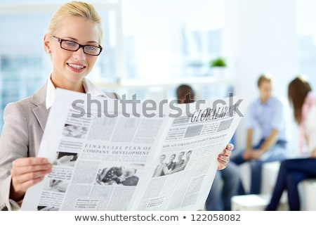 pretty blonde reading the newspaper stock photo © wavebreak_media