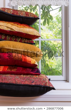 piled authentic pillows in front glass window stock photo © ozgur
