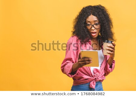 Woman holding coffee cup while looking away Stock photo © wavebreak_media