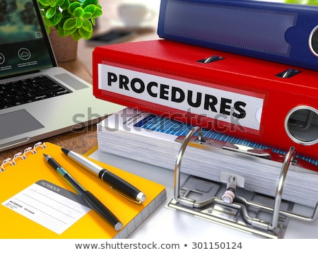 Red Ring Binder with Inscription Procedures. Stock photo © tashatuvango