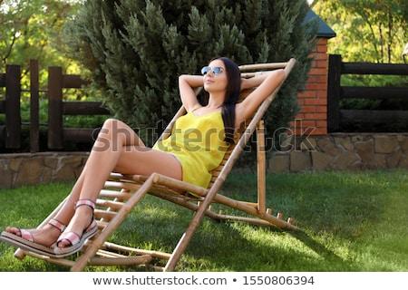 Femme jeune femme parasol plage fille soleil Photo stock © Gbuglok