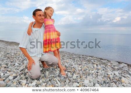 Stockfoto: Jonge · man · meisje · strand · familie · glimlach · gelukkig