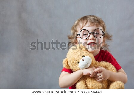 three year old boy with a toy bear on white background Stock photo © RuslanOmega