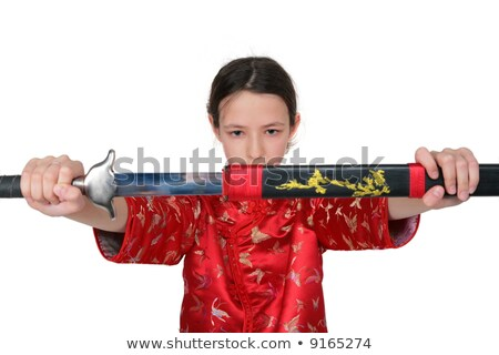 Kung fu girl takes out sword Stock photo © Paha_L