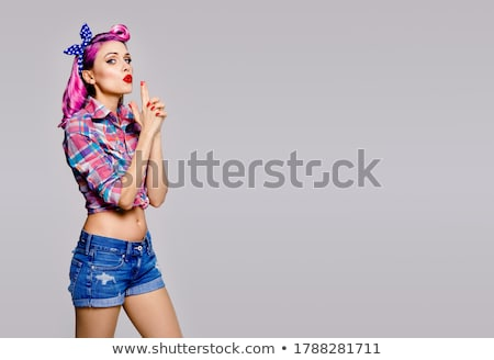 happy attractive woman in retro style posing over white background stock photo © deandrobot